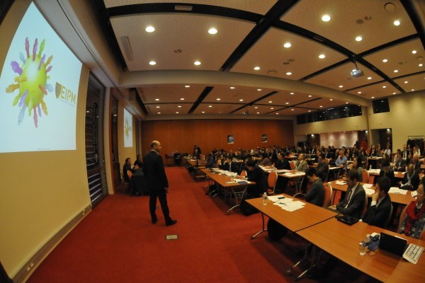 A fish-eye shot of the audience during the EIPM Annual Purchasing Conference